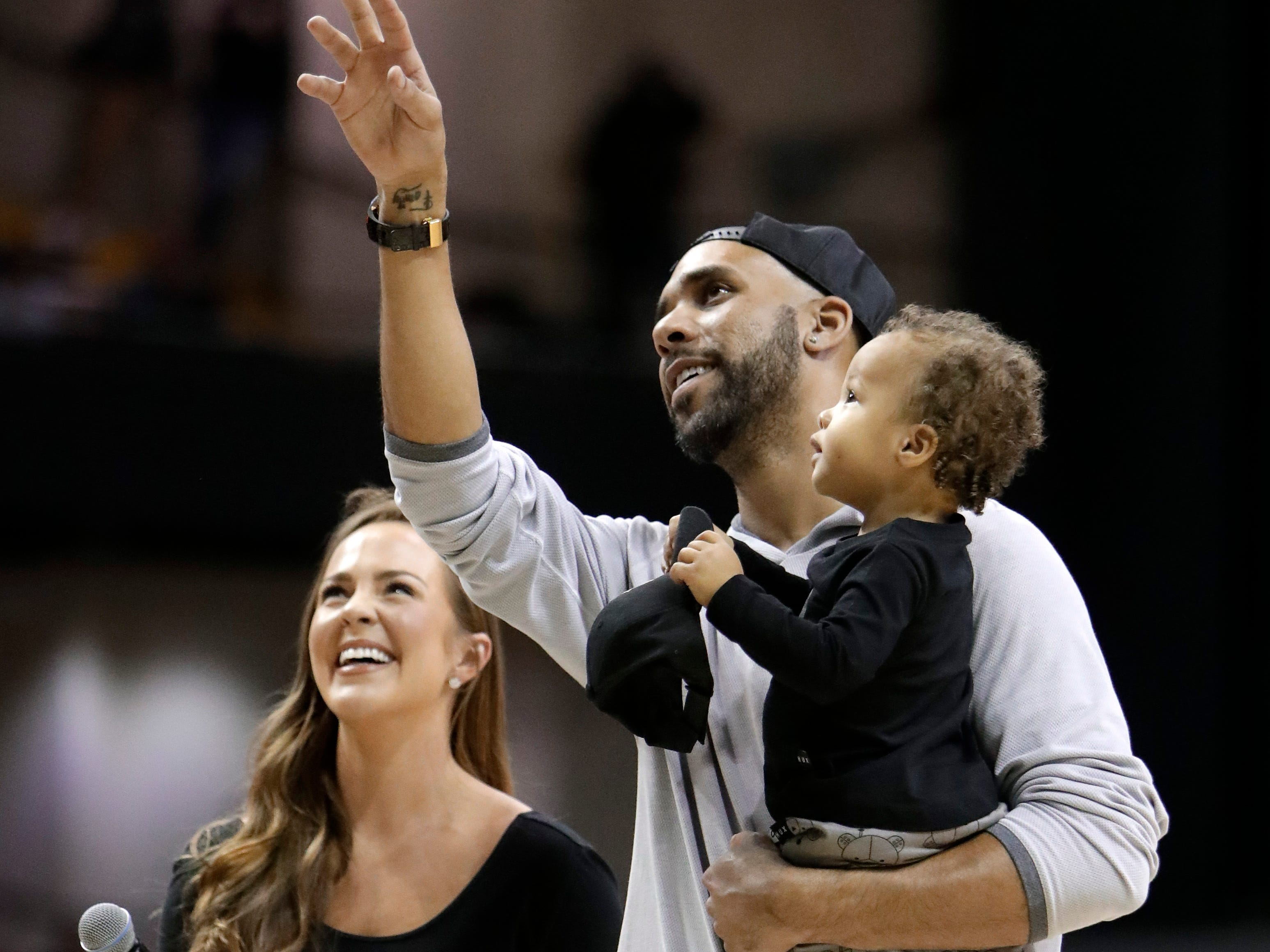 Boston Red Sox pitcher David Price holds his son, son, Xavier, as he talks to the crowd during a game between Vanderbilt and Mississippi State on Jan. 19, 2019.