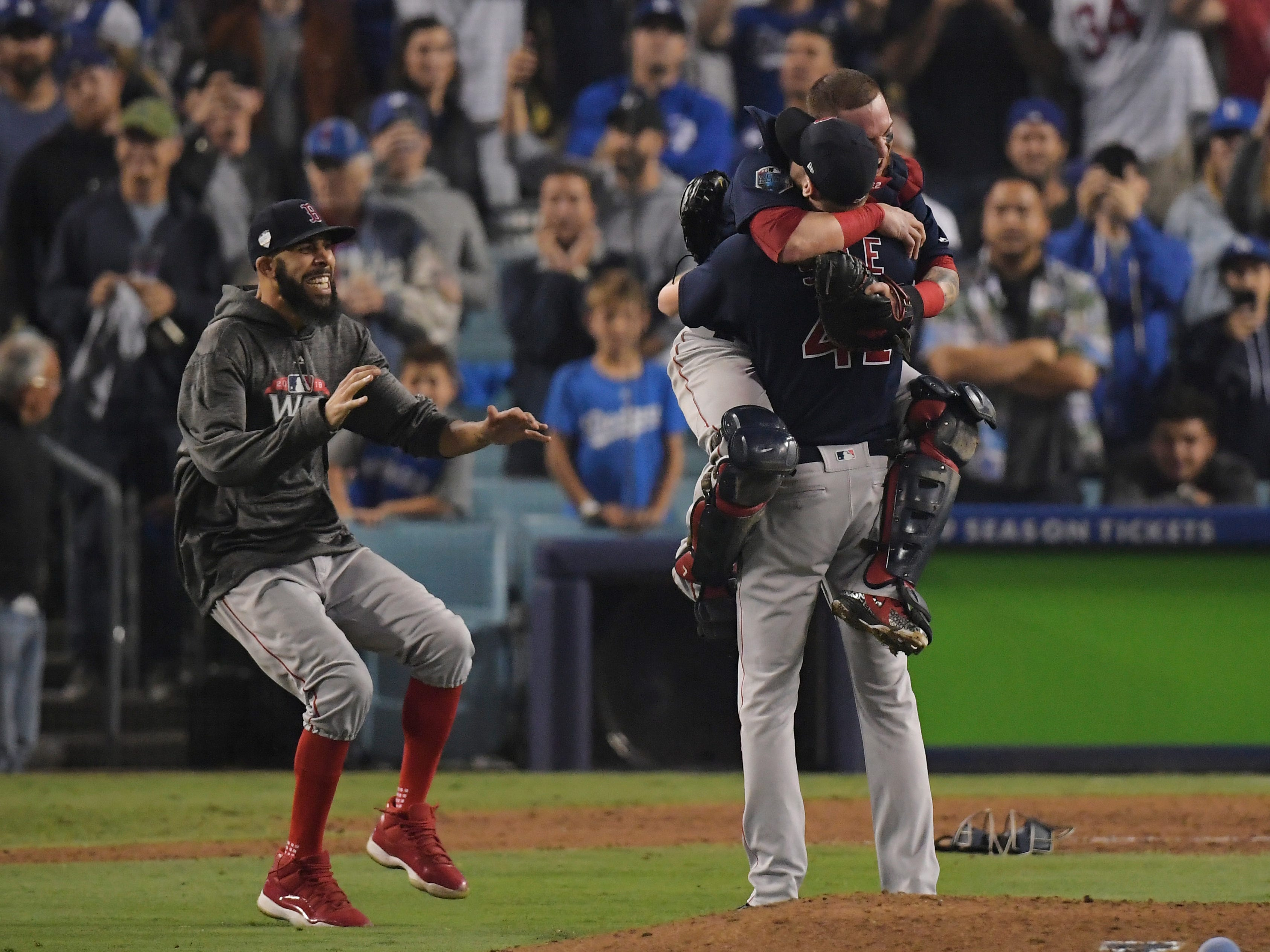 From left, Boston Red Sox's David Price, catcher Christian Vazquez and Chris Sale celebrate after Game 5 of baseball's World Series against the Los Angeles Dodgers on Sunday, Oct. 28, 2018. The Red Sox won 5-1 to win the series 4 games to 1.
