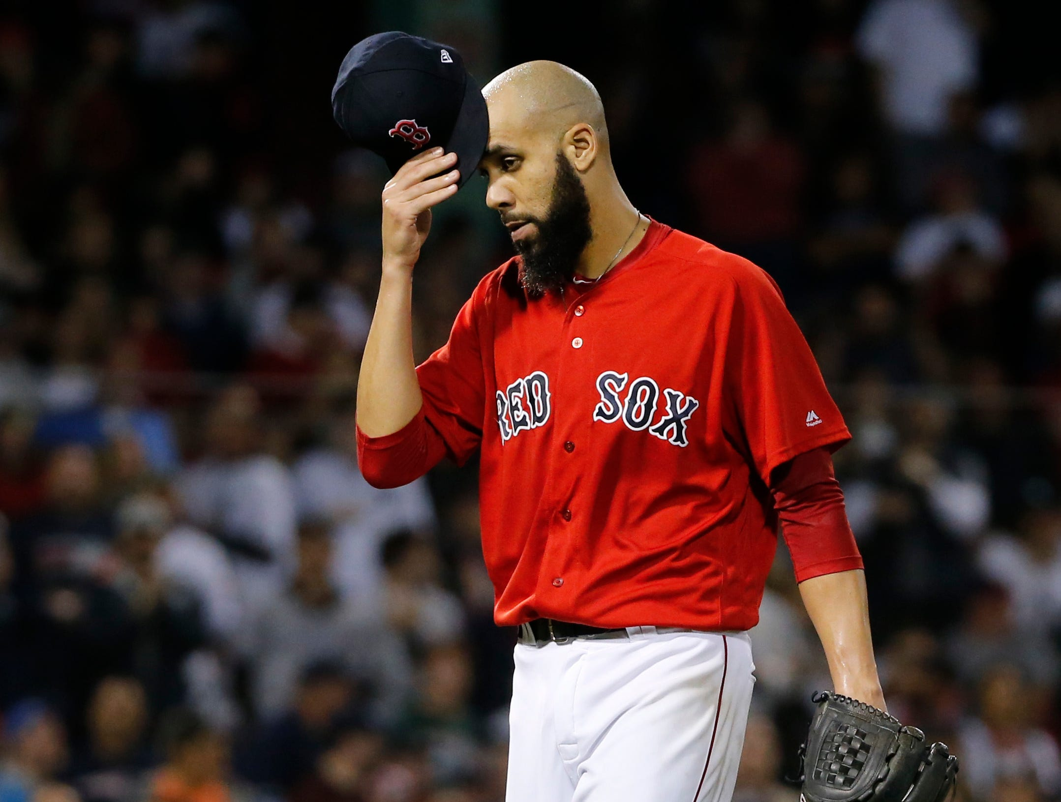 Boston Red Sox starting pitcher David Price is taken out during the second inning of Game 2 of the American League Division Series against the New York Yankees, Saturday, Oct. 6, 2018, in Boston.