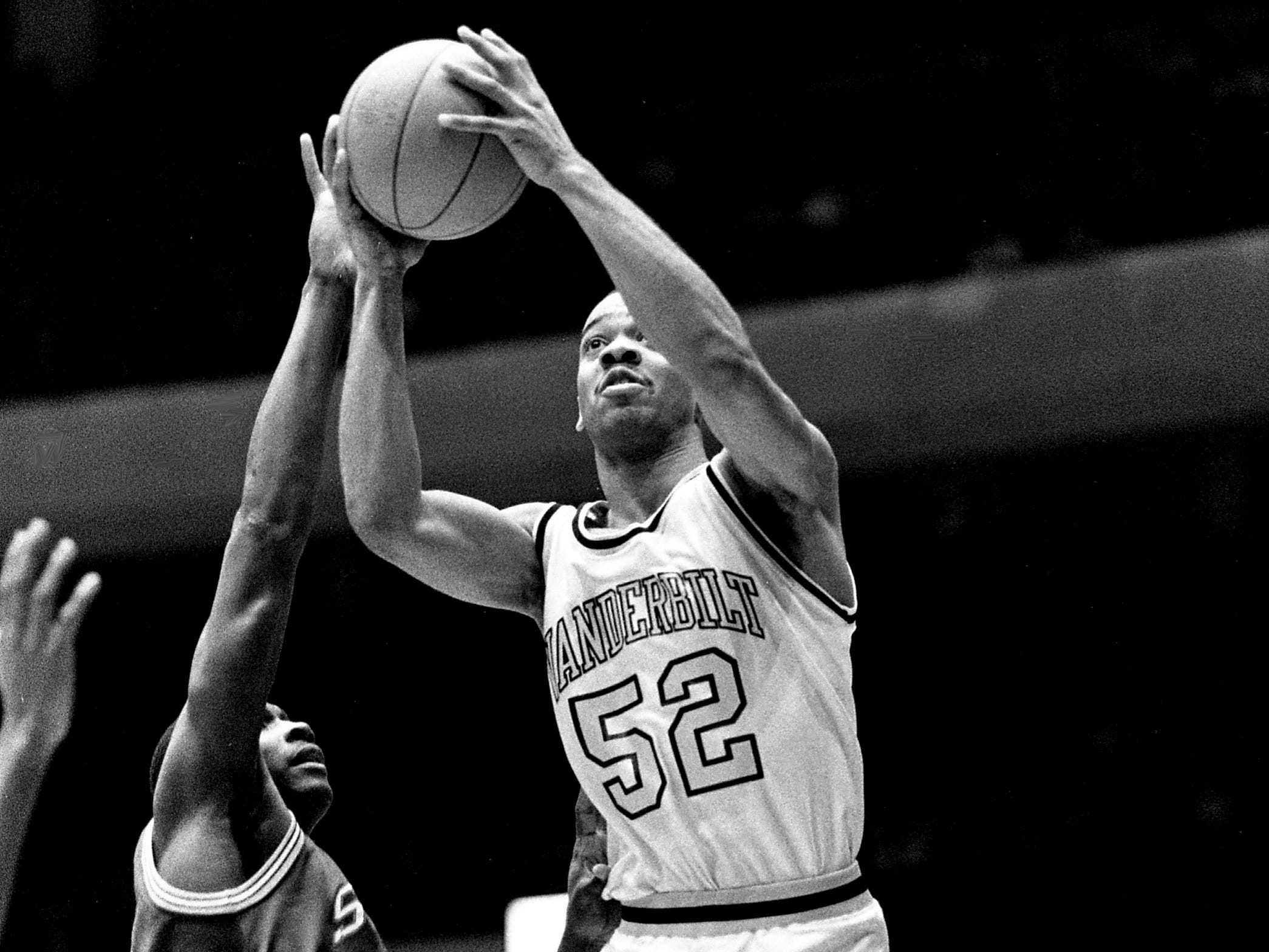 Vanderbilt junior forward Eric Reid (52) goes past Mississippi State defender Tony Watts for two of his 12 points in their 77-58 victory before 15,646 fans at Memorial Gym on March 1, 1989. Reid pulled down a career-high 13 rebounds.