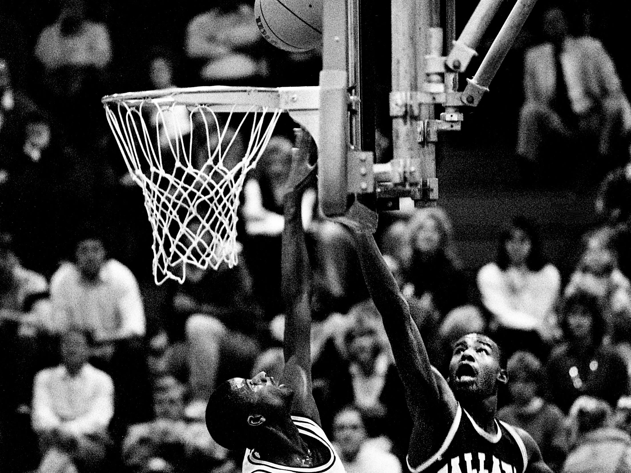 Gallatin High's Malcolm Montgomery (23) gets a shot up over the reach of Clarksville High's Henry Thomas in the TSSAA Region 5-AAA semifinal at Volunteer State in Gallatin on March 1, 1989. Montgomery scored 23 points, but Thomas scored a game high 33 points in leading Clarksville to a 94-82 victory.