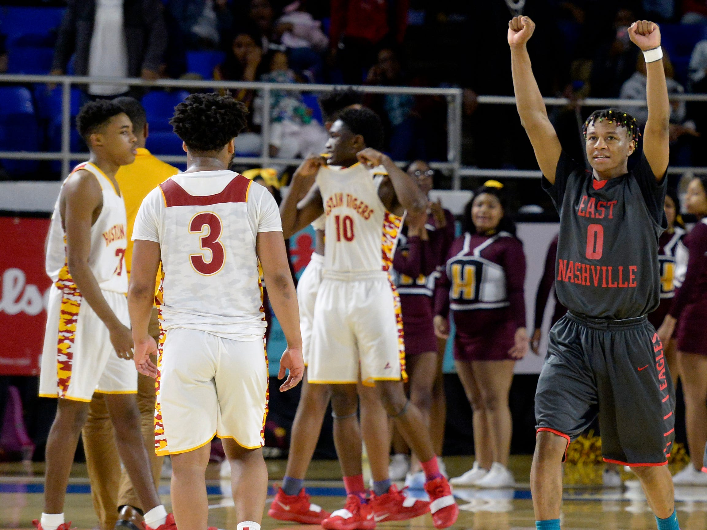 East Nashville guard Taras Carter (0) celebrates after the team's 78-75 win against Howard in an Class AA boys' state basketball quarterfinal game Wednesday, March 13, 2019, in Murfreesboro, Tenn.