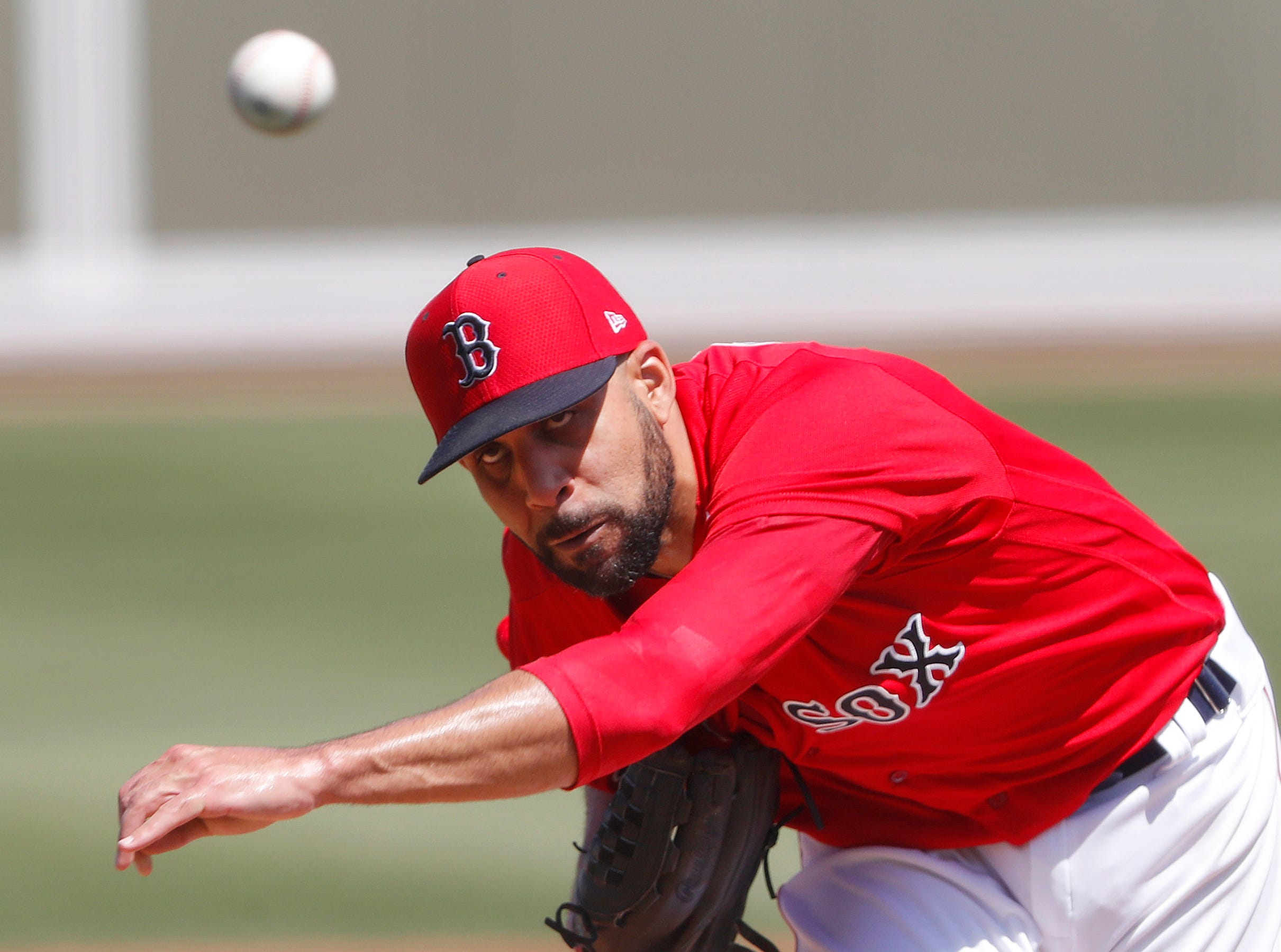 Boston Red Sox starting pitcher David Price delivers a pitch in the second inning of a spring training baseball game against the Detroit Tigers on March 12, 2019, in Fort Myers, Fla.