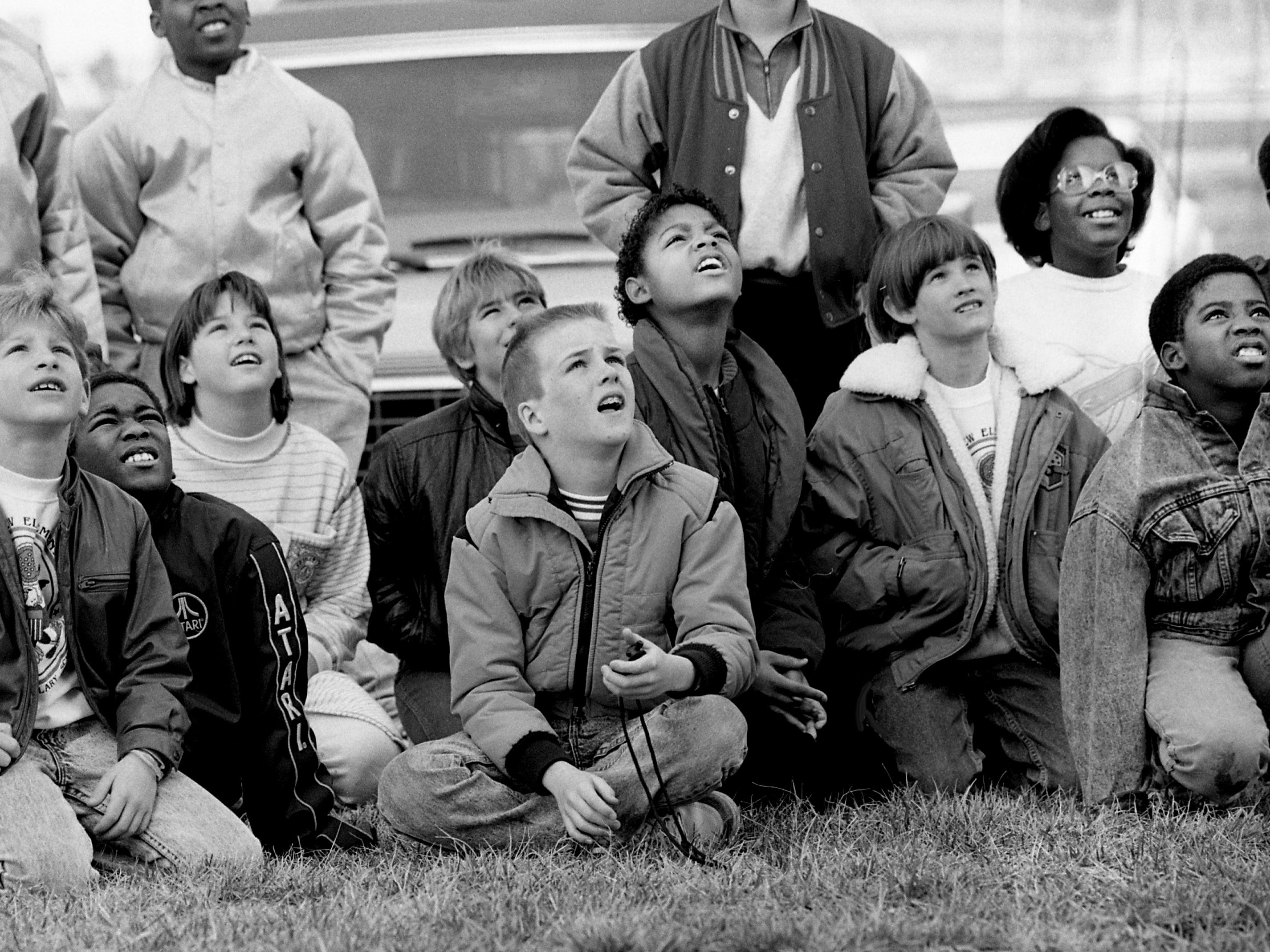 Lakeview Elementary School fourth-grade students watch teachers Charles Sellars and Mary McHugh throw their space transportation projects Nashville International Airport on March 2, 1989.