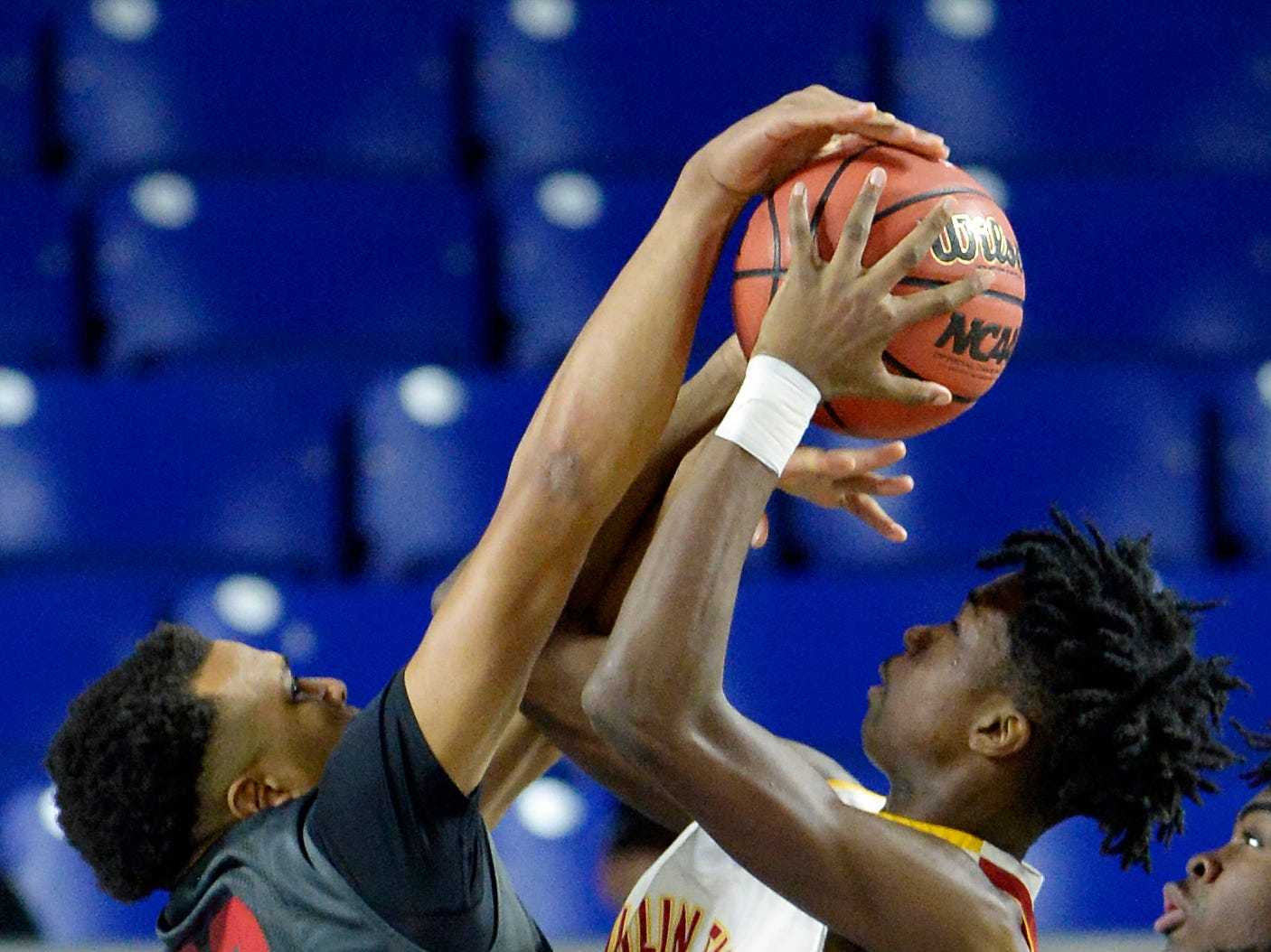 East Nashville forward Lester Shaw (10) blocks a shot by Howard forward Kerrick Thorne (14) during the first half of a Class AA boys' state basketball quarterfinal game Wednesday, March 13, 2019, in Murfreesboro, Tenn.