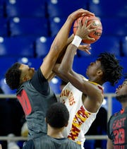 East Nashville's Lester Shaw (10) blocks a shot by Howard's Kerrick Thorne (14) during the first half Wednesday.