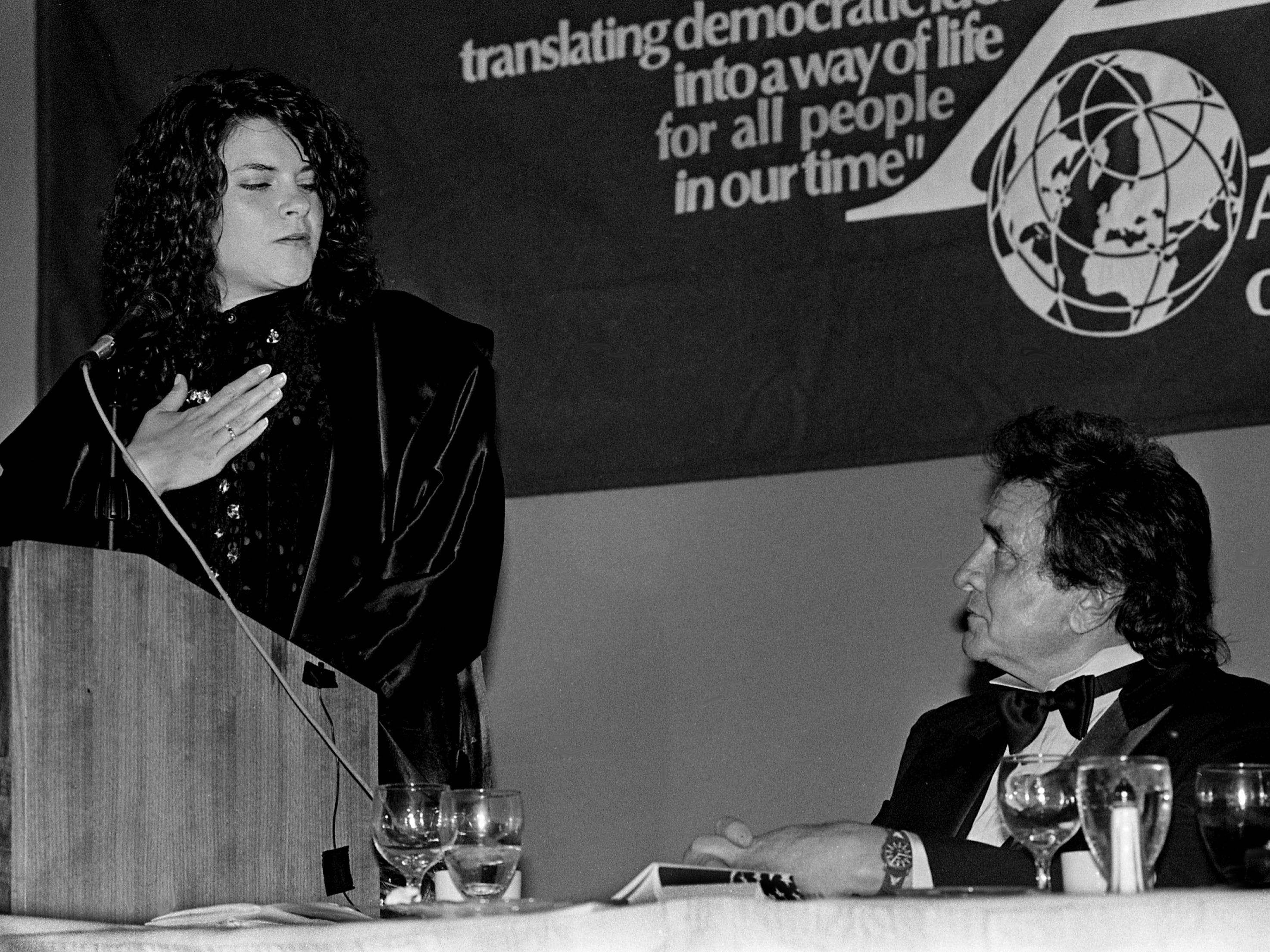Rosanne Cash, left, speaks to her father, Johnny Cash, who is receiving a B'nai B'rith's Anti-Defamation League honor that will be renamed the Johnny Cash Americanism Award, during ceremonies at the Doubletree Hotel on March 30, 1989.