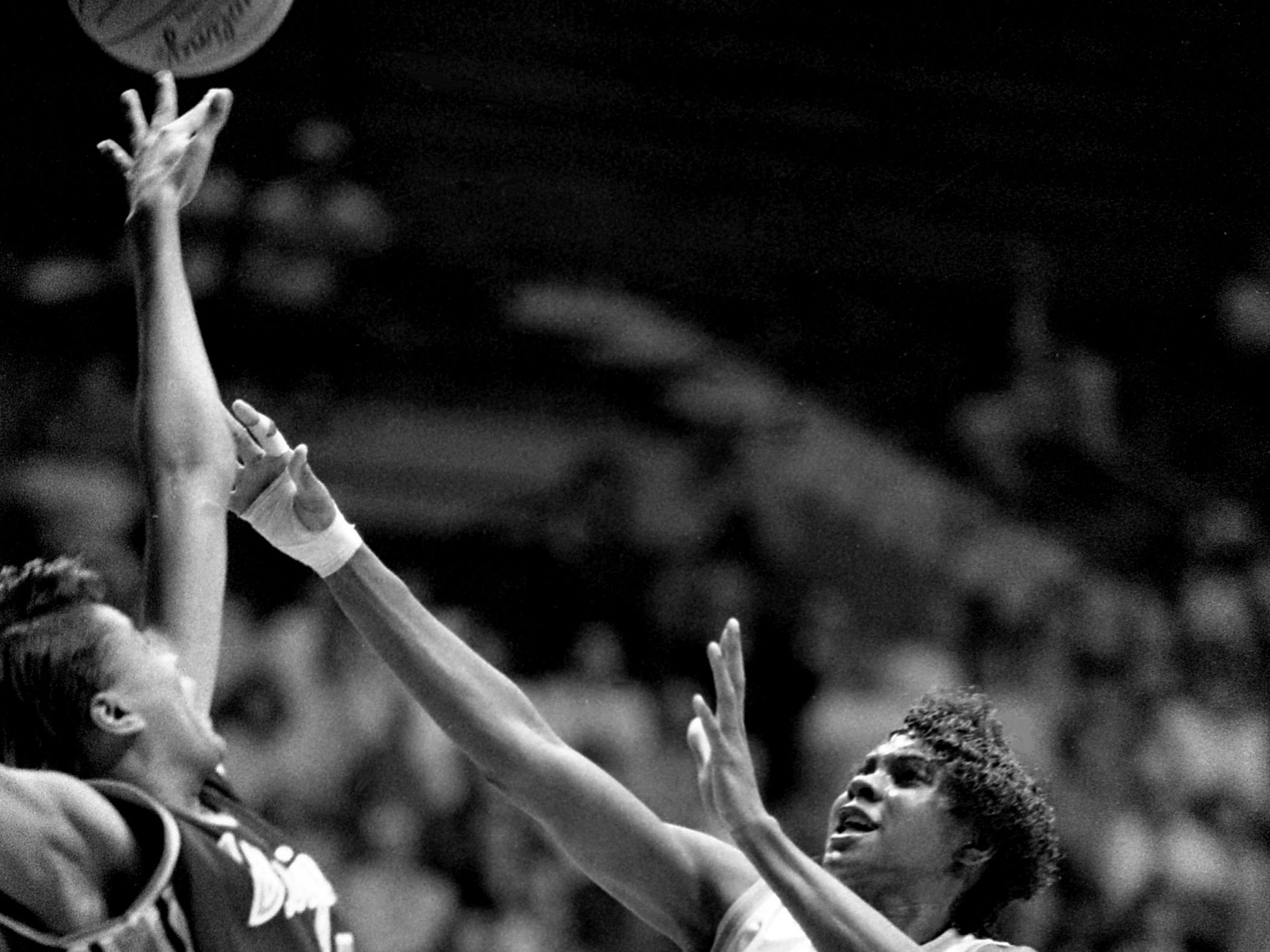 Tennessee senior Bridgette Gordon (30) gets her shot off over Virginia defender Audra Smith. The No. 1 ranked Lady Vols smashed Virginia 80-47 in the NCAA East Regional semifinals at Western Kentucky's Diddle Arena in Bowling Green, Kentucky, March 23, 1989.