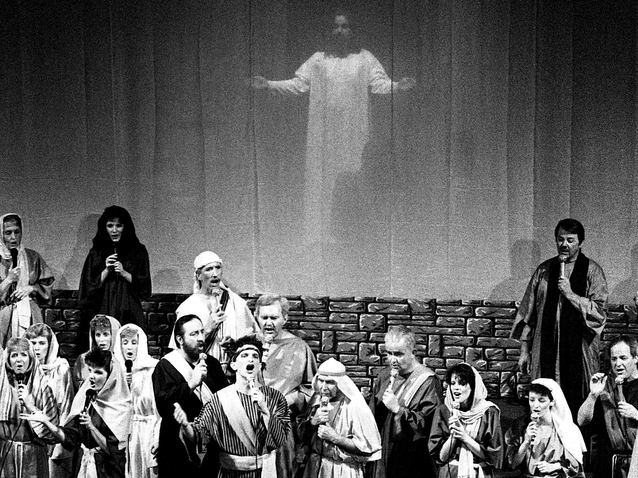 Jesus, portrayed by Bill Hart, rises above the faithful during the annual Passion play presented by the Grace Church of the Nazarene on Pennington Bend Road on March 24, 1989. It is one of the more noted observances of Easter in the Nashville Area.