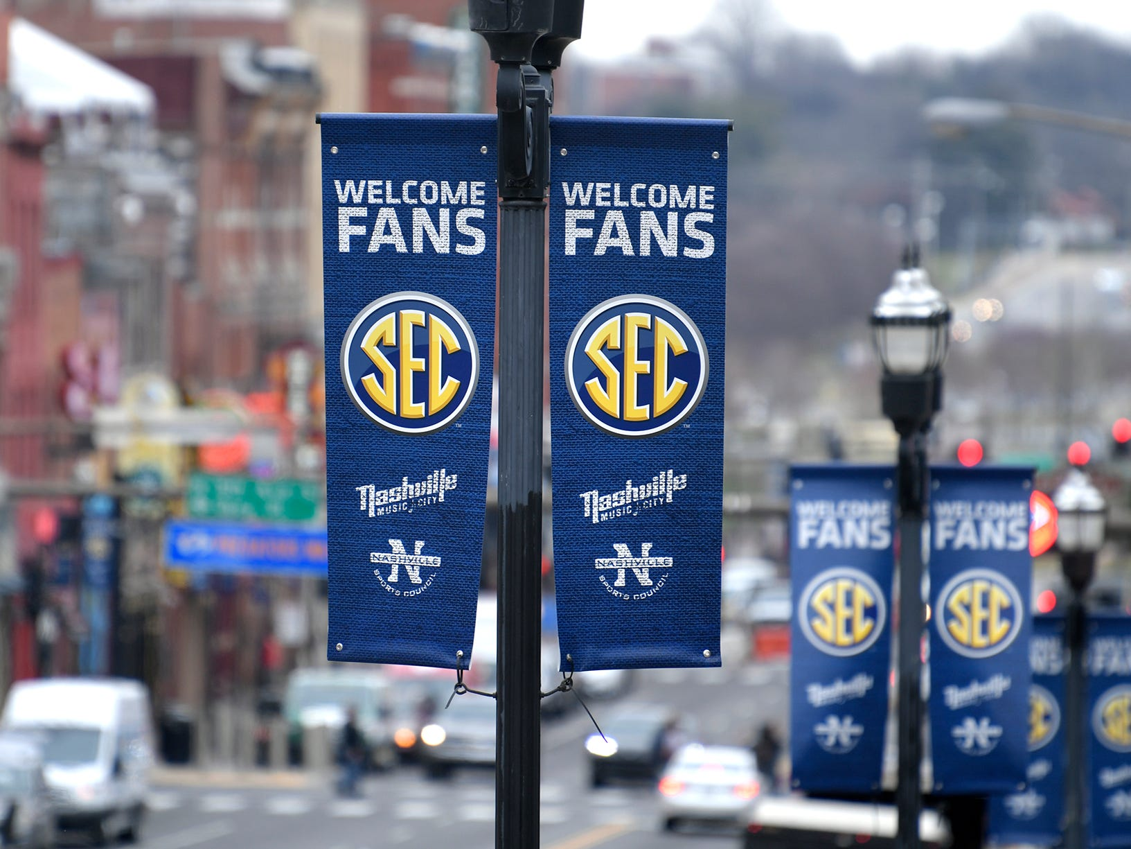 SEC Men's Basketball Tournament banners hand in downtown Nashville on Wednesday, March 13, 2019.