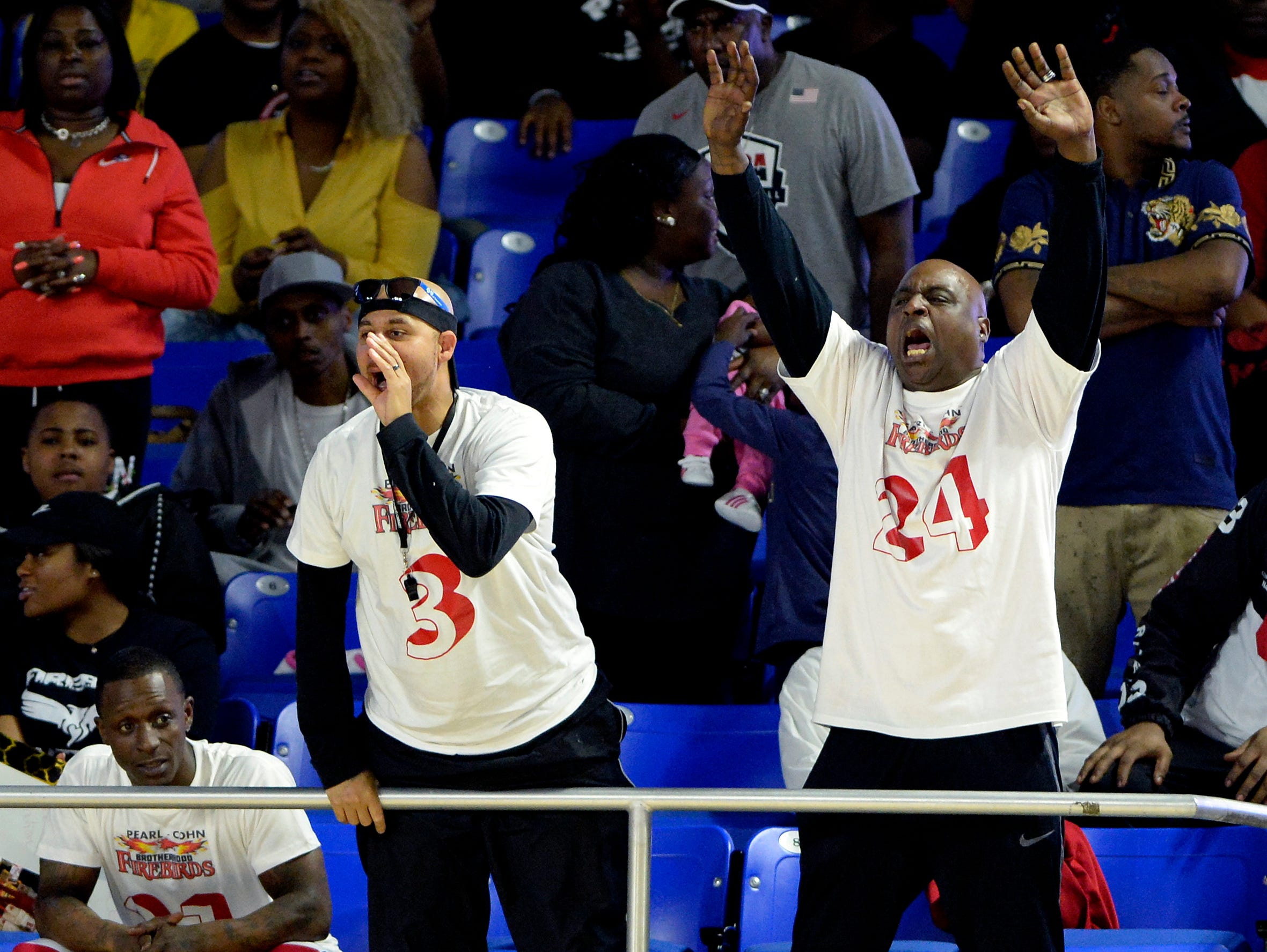 Pearl-Cohn fans cheer during the first half of an Class AA boys' state basketball quarterfinal game against Brainerd Wednesday, March 13, 2019, in Murfreesboro, Tenn.
