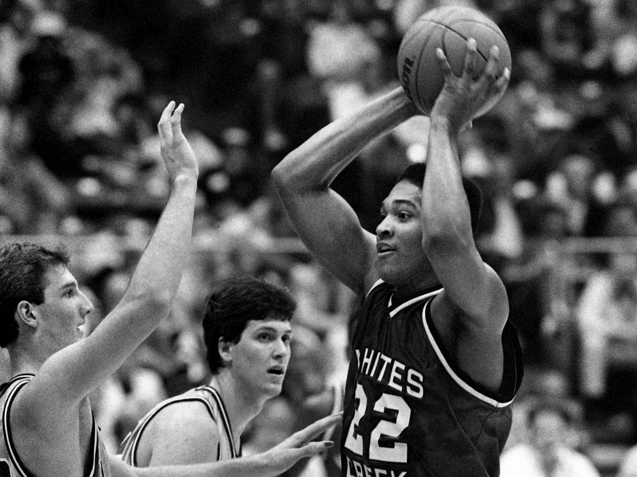 White Creek High's Brian Ward (22) is being hounded by Kevin Anglin, left, and Jay Johnson of Franklin High. Anglin scored 25 points for Franklin to win the TSSAA Class AAA title 43-42 at MTSU's Murphy Center in Murfreesboro on March 18, 1989.