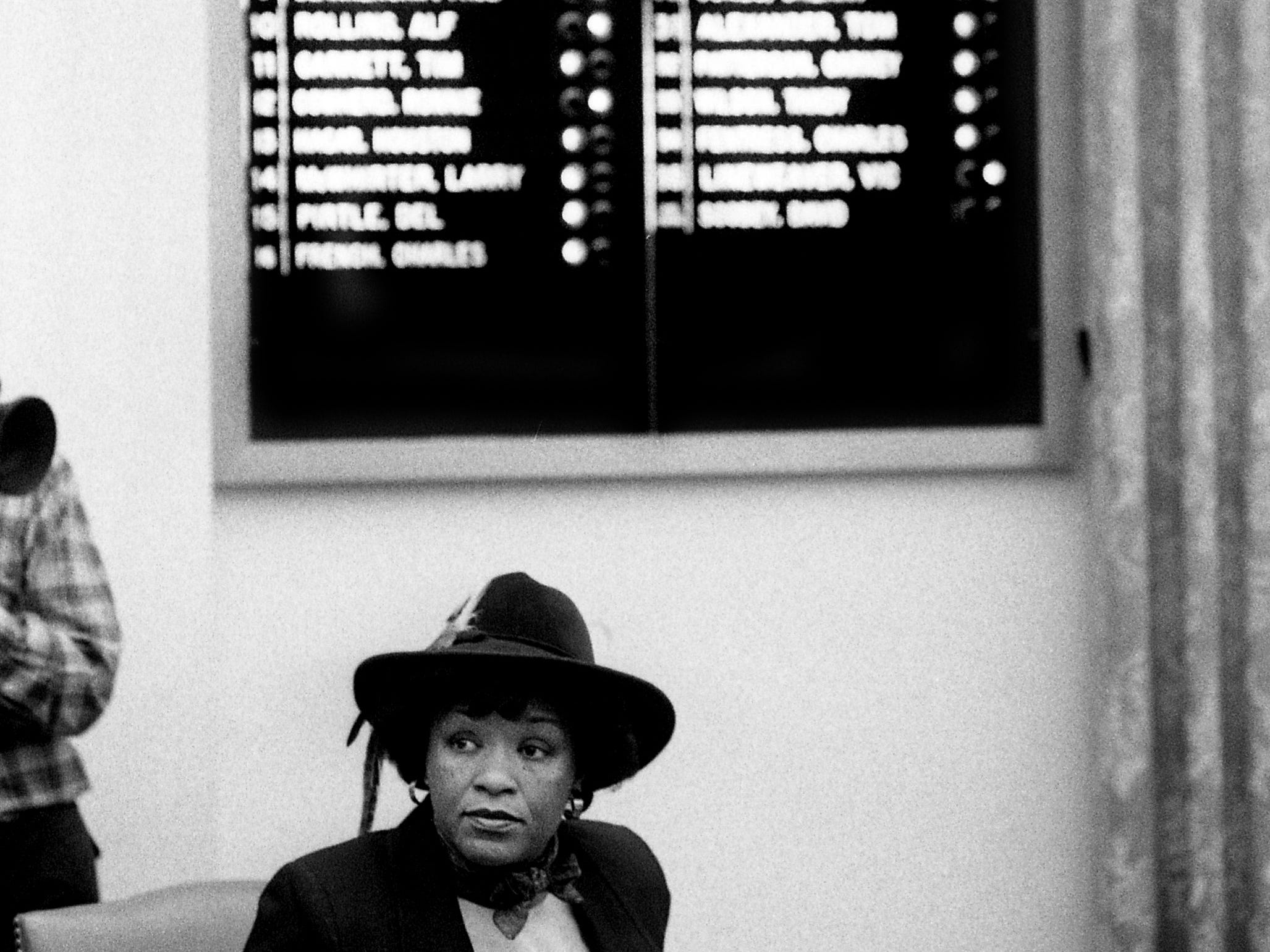 Metro Councilwoman Thelma Harper sits beneath the electronic tally board that shows the vote on final reading of a bill allowing Metro to condemn land for testing four potential landfill sites at the Metro Courthouse on March 7, 1989. Property on Neely's Bend, Hadley Bend, Whites Bend and Bells Bend sites may be condemned for testing after the 25-13 vote.