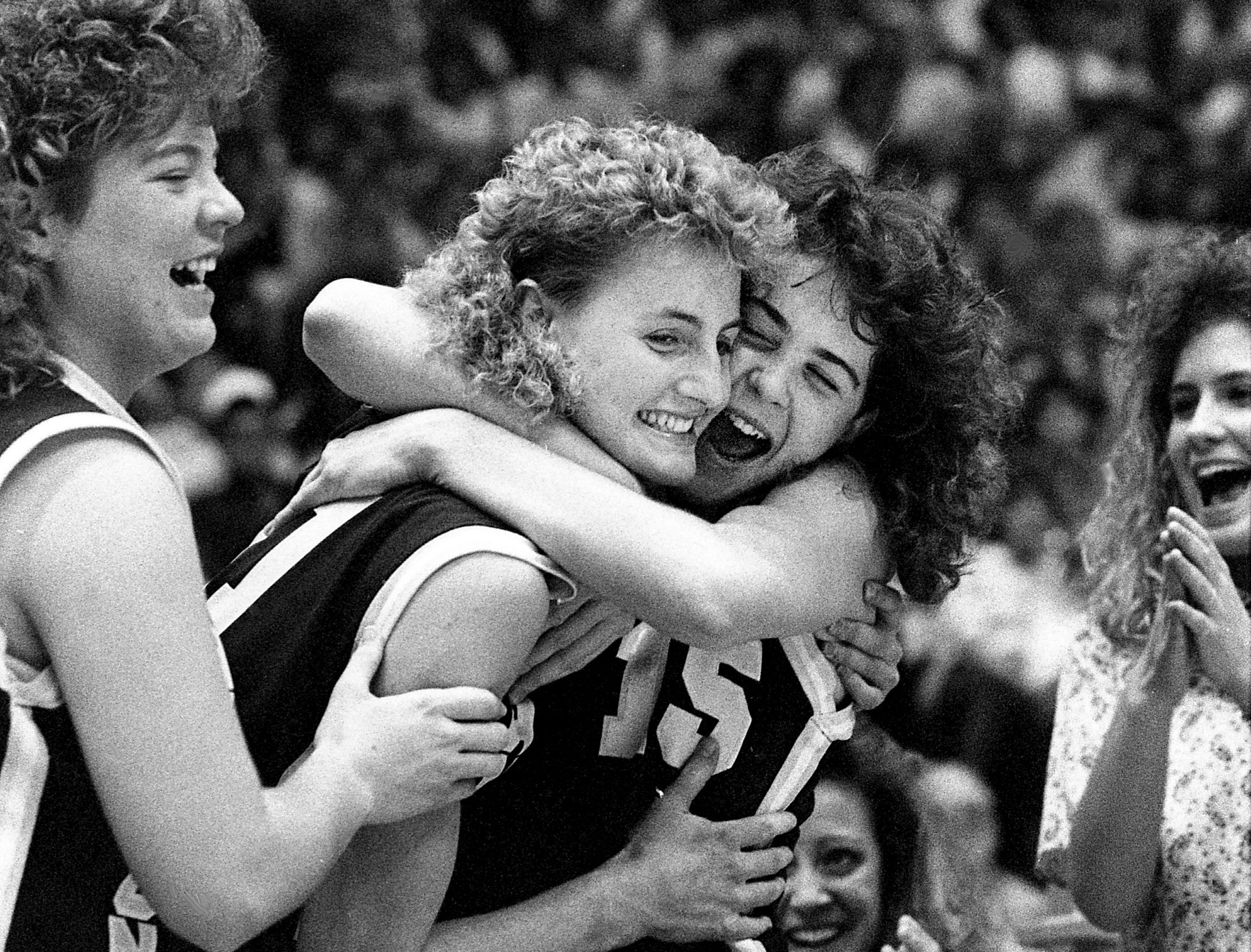 Cannon County High star Julie Powell, center, celebrates with teammates Charlotte Banks, left, and Catherine Reed after defeating Happy Valley High 51-46 in the TSSAA Class AA State Tournament at MTSU's Murphy Center in Murfreesboro on March 11, 1989. Cannon County had lost in the finals the past two years to South Greene High.