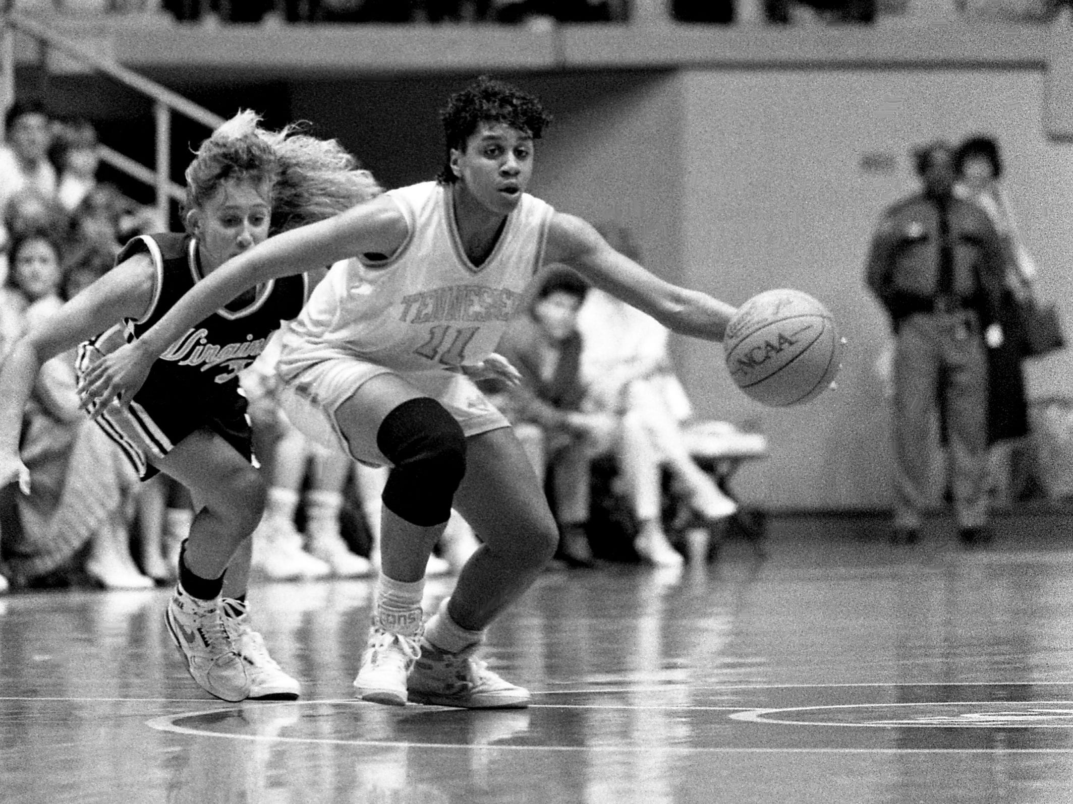 Tennessee point guard Dena Head (11) works her way up court, leaving Virginia defender Tammi Reiss behind. The No. 1 ranked Lady Vols smashed Virginia 80-47 in the NCAA East Regional semifinals at Western Kentucky's Diddle Arena in Bowling Green, Kentucky, March 23, 1989.