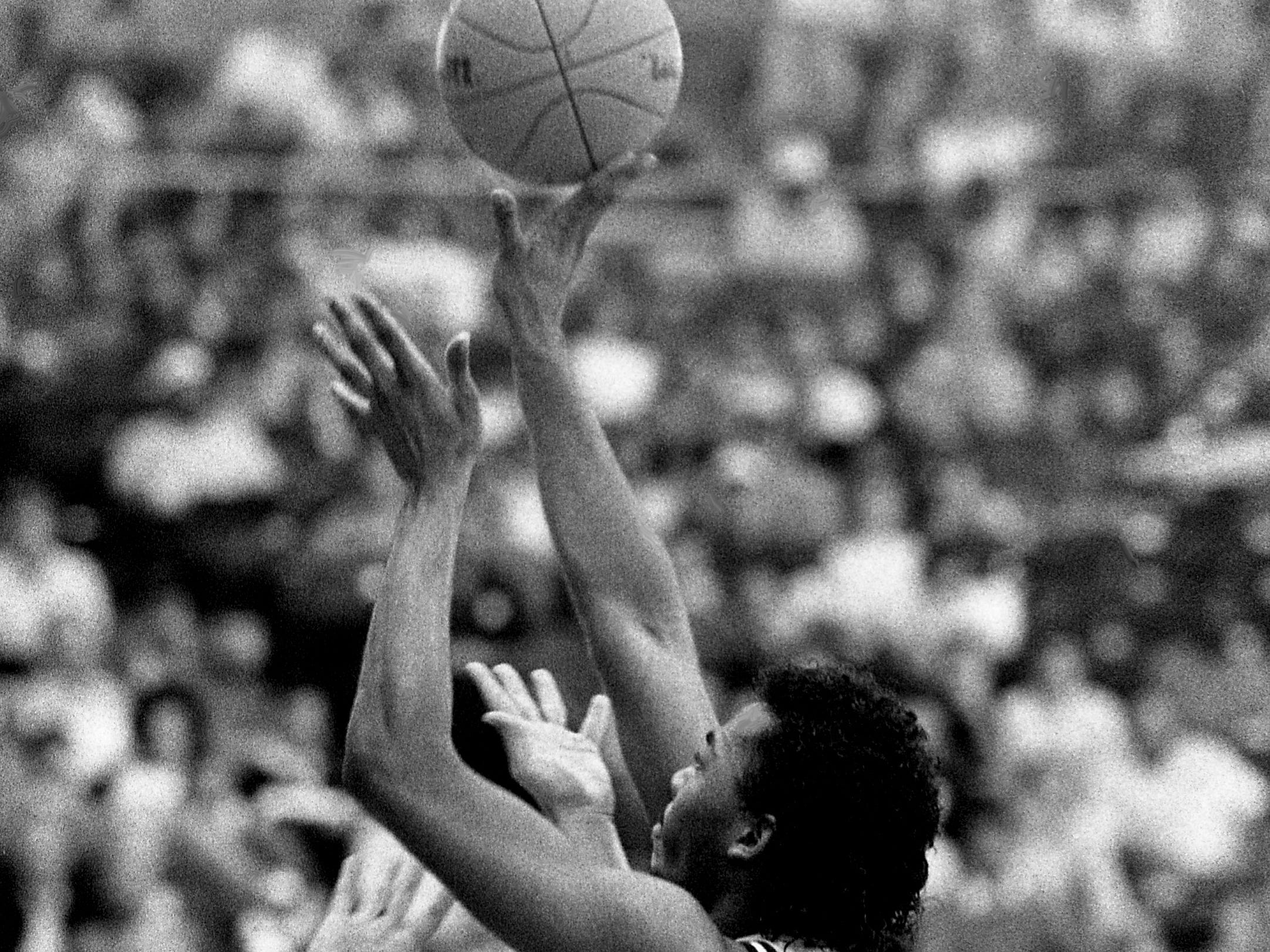 East Robertson High senior Carlus Groves puts up the game-winning shot over Perry County High defender Stephen Lebetter in the TSSAA Class A semifinal game at MTSU's Murphy Center in Murfreesboro March 17, 1989. The 63-61 victory allows East Robertson to defend it two straight Class A titles and their bid to win three consecutive Class A titles.