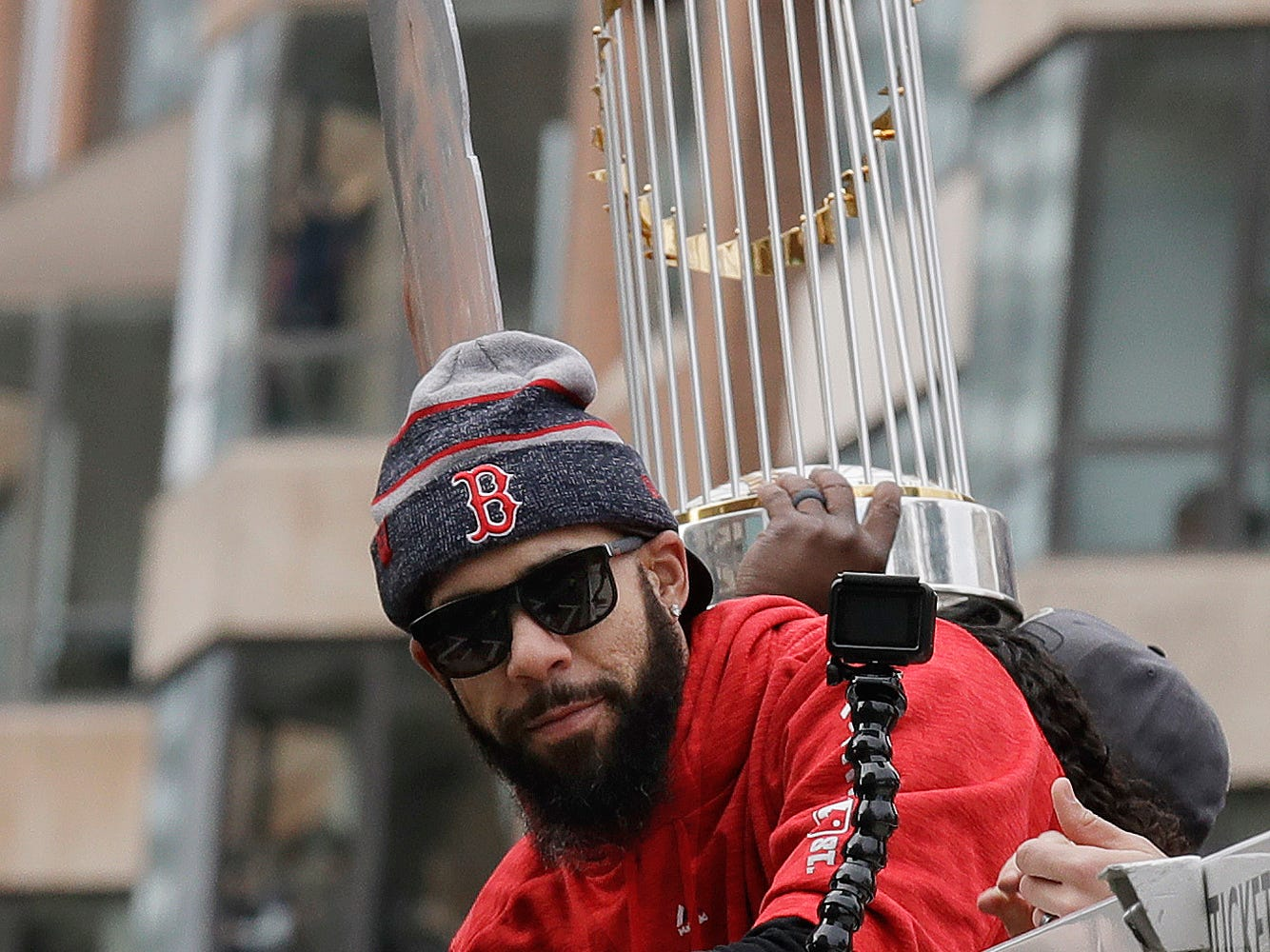 Boston Red Sox's David Price rides with the trophy during a parade to celebrate the team's World Series championship over the Los Angeles Dodgers on Oct. 31, 2018, in Boston.