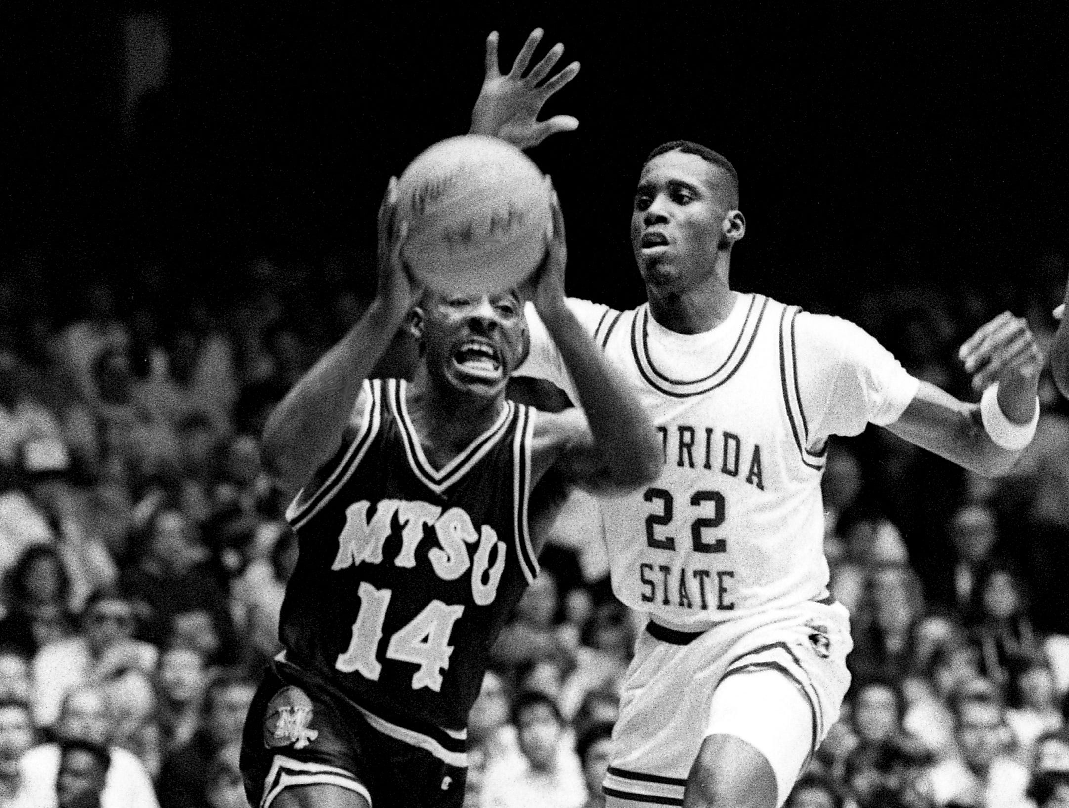 Middle Tennessee State guard Gerald Harris (14) is ready to make a move while Tharon Mayes (22) of Florida State tries to stop him. The Blue Raiders stunned 14th ranked Florida State 97-83 in the first round of the NCAA Southeast Regional at Vanderbilt's Memorial Gym on March 16, 1989.