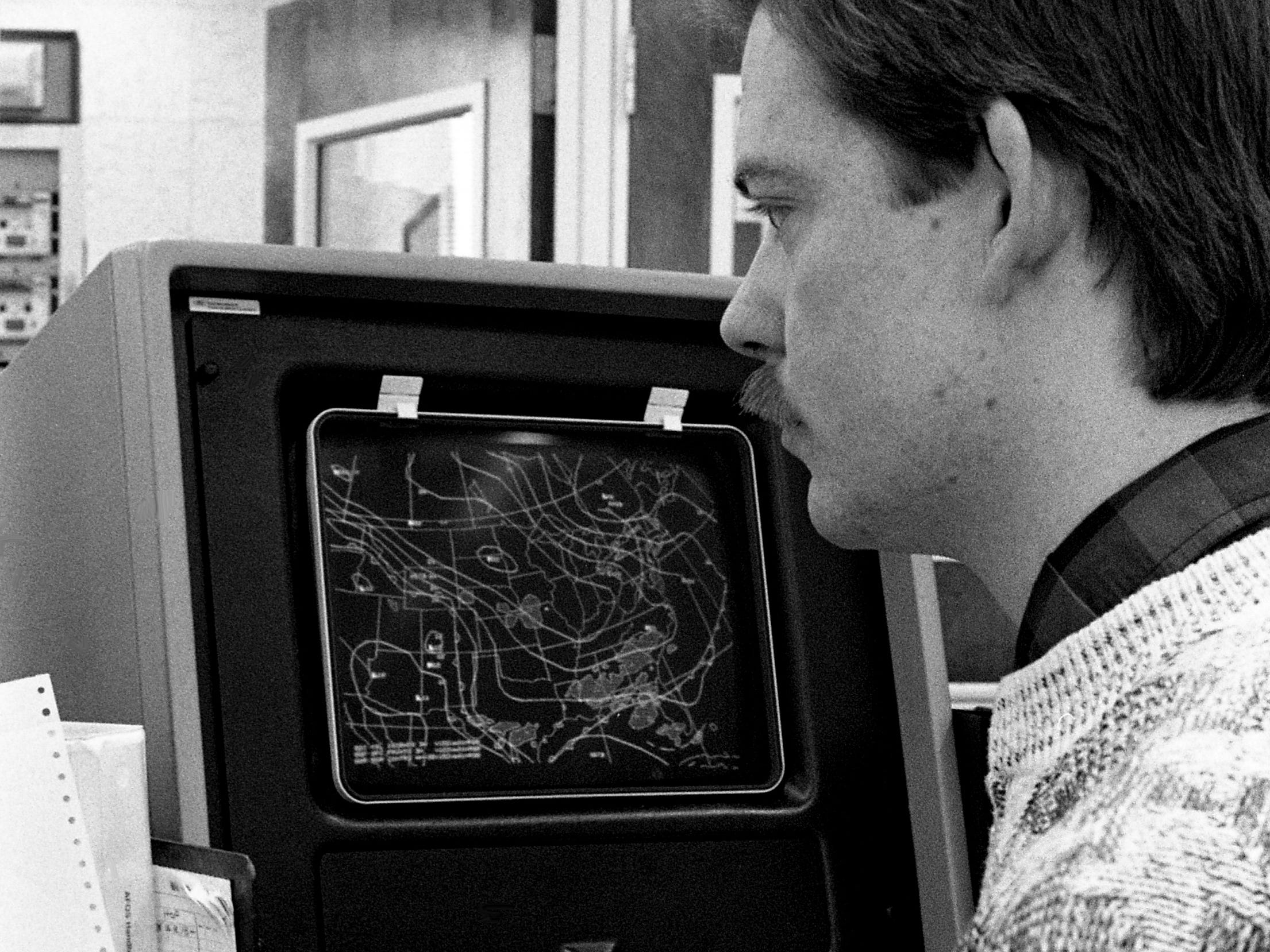National Weather Service meteorologist Doug Boyette calls up a weather map on the computer March 1, 1989. The office, which employs five weather observers and a supervisor, is responsible for local weather forecasts.