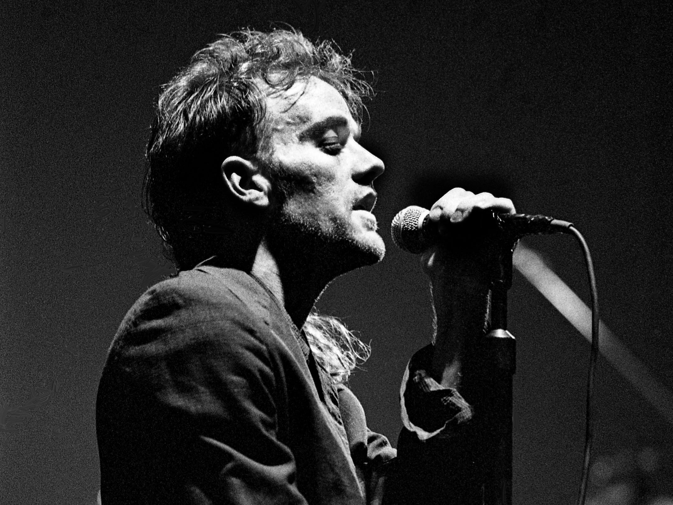 """Michael Stipe, lead singer for the rock band R.E.M., performs """"Pop Song 89"""" as the group kicks off its concert before about 10,000 fans at MTSU's Murphy Center in Murfreesboro on March 31, 1989. R.E.M. performed most of its new album """"Green,"""" as well as selections from earlier discs."""