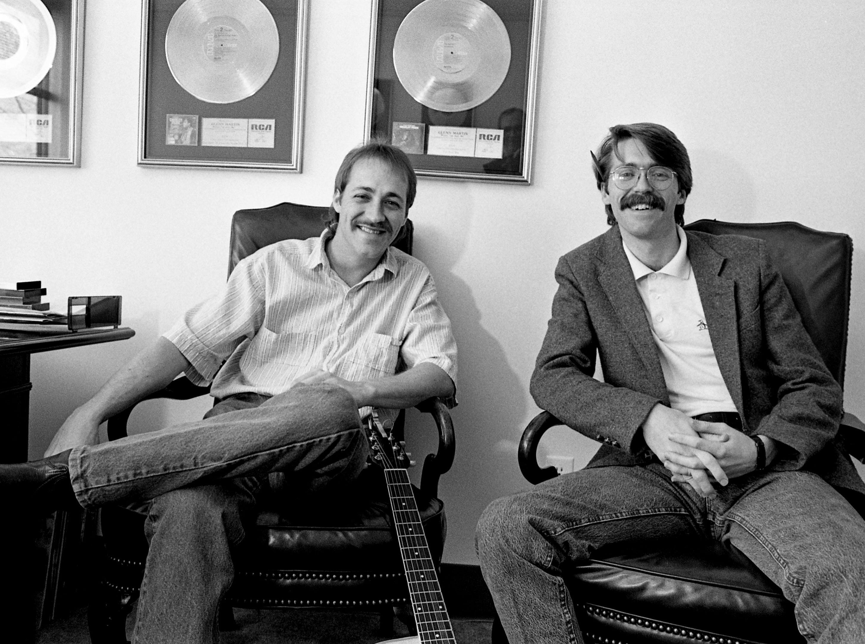 """Brothers Troy and Tony Martin shares a moment in their father, songwriter Glenn Martin, Co-Heart Music Group publishing company March 17, 1989. The second-generation songwriter brothers have written George Strait's new No. 1 single, """"Baby's Gotten Good at Goodbye."""""""