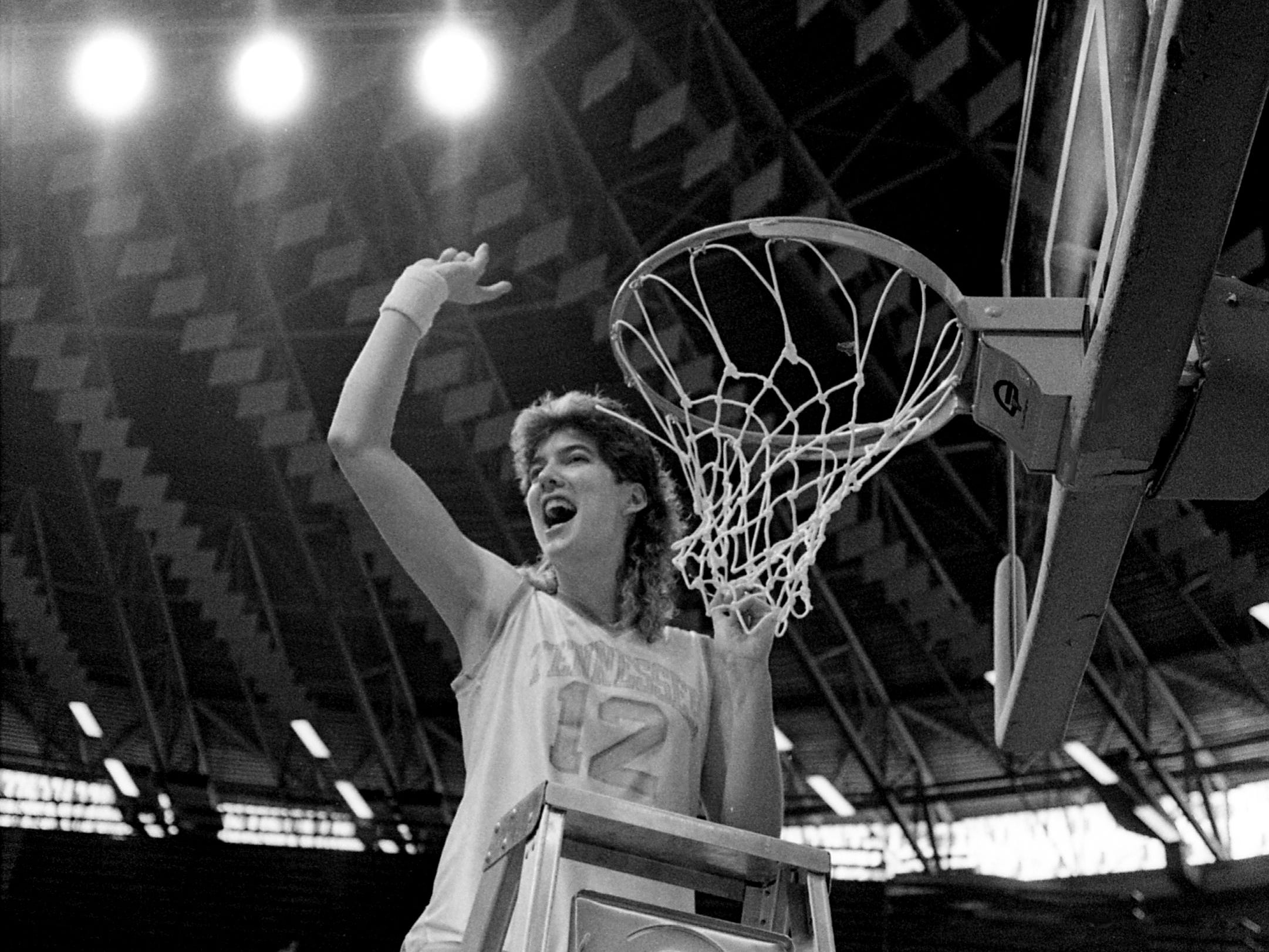 Tennessee senior Sheila Frost, a Pulaski native, waves to the crowd as she prepares to help cut down the net after the Lady Vols 94-80 victory over Long Beach State in the NCAA East Regional championship game at Western Kentucky's Diddle Arena in Bowling Green, Kentucky, March 25, 1989. Frost, along with fellow seniors Bridgette Gordon and Melissa McCray, became the first senior class in the history of collegiate women's basketball to earn Final Four berths in each year of their eligibility.