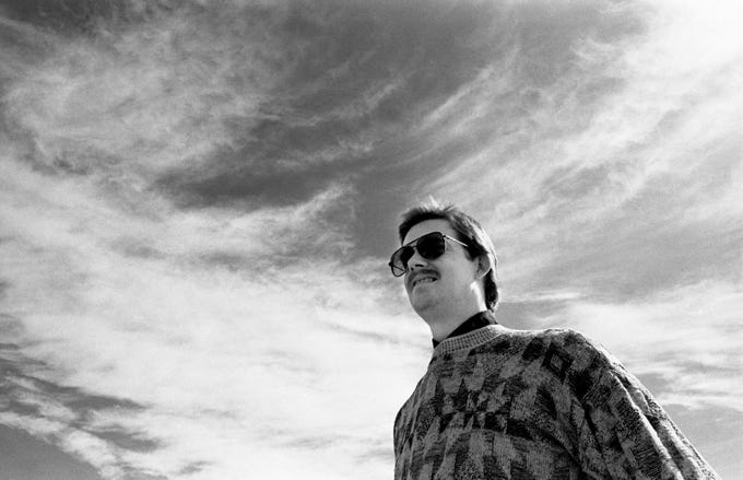 National Weather Service meteorologist Doug Boyette scans the skies as part of his hourly check of local conditions March 1, 1989. The wispy, cirrus clouds indicate fair weather.