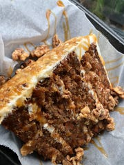 Island Gypsy Poolside Cafe's carrot cake is a massive slice, drizzled with caramel and encrusted with walnuts.