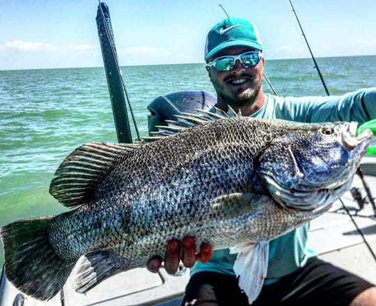 Kenny from South Dakota with a stud tripletail Fishing with Capt Christian sommer using squid.
