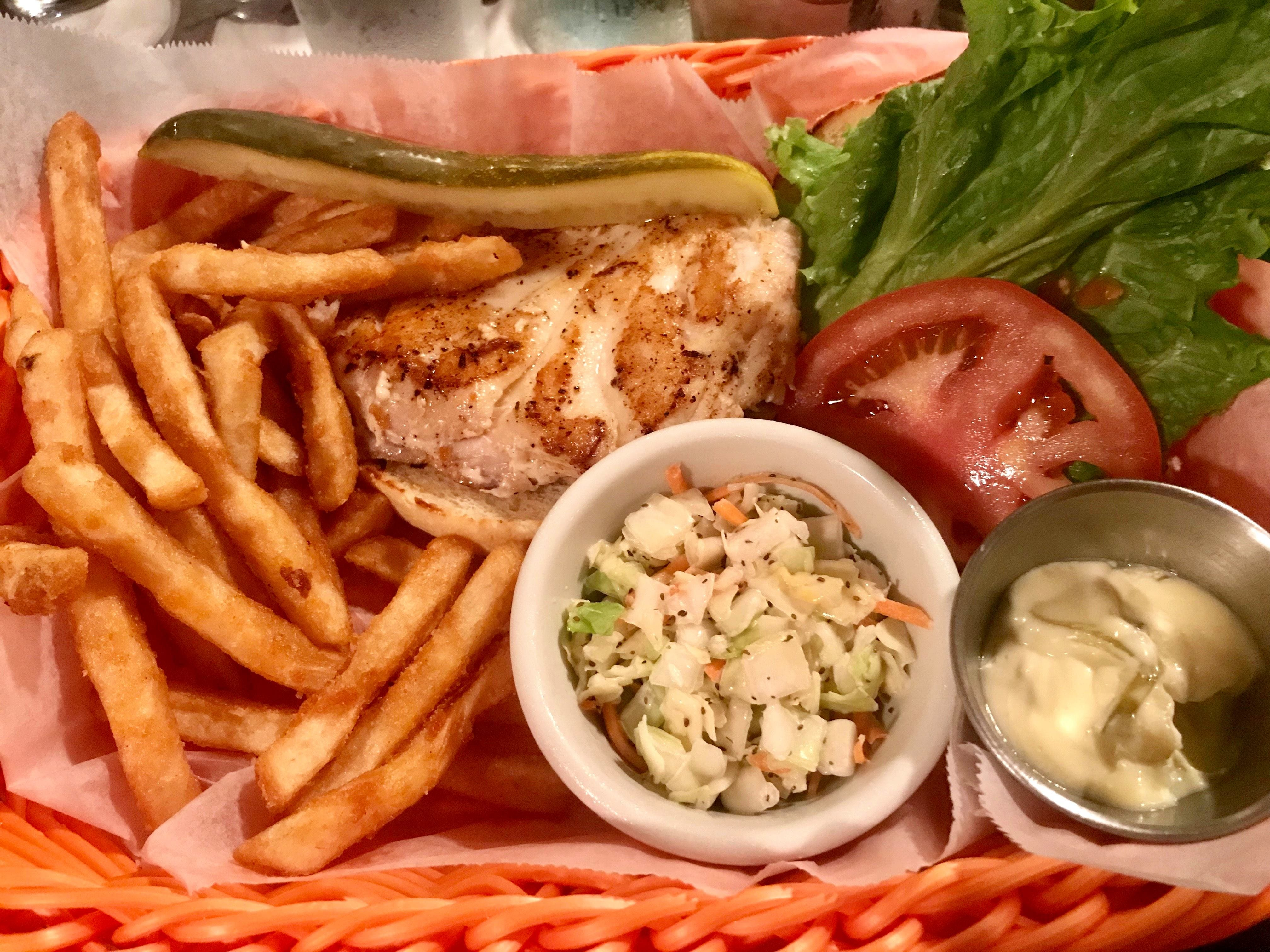 "The grouper sandwich is ""locally world famous"" at Island Gypsy Poolside Cafe."