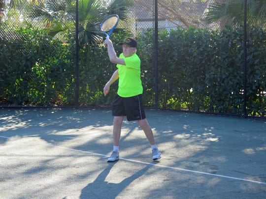 Dick Sauer, 92, follows through on a shot during a recent Saturday tennis session at Vi at Bentley Village. Sauer and his wife Elaine recently moved to the community, where he has fit right in with the group of 20-24 regular tennis players that meet three times a week.