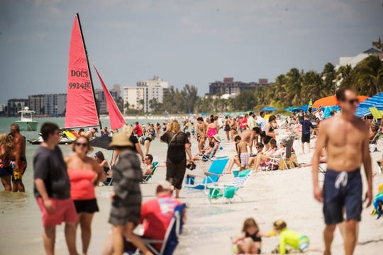 Visitors to Bonita Beach bask in the warm weather on Wednesday 3/13/2019.