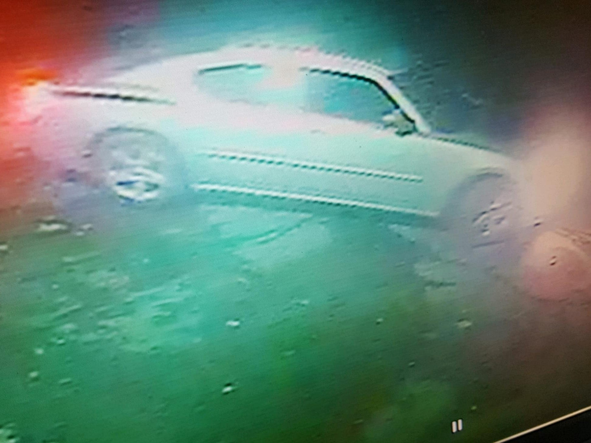 Surveillance footage of the vehicle of a suspect who stole cash and liquor from Crossroads Bar on National Road.