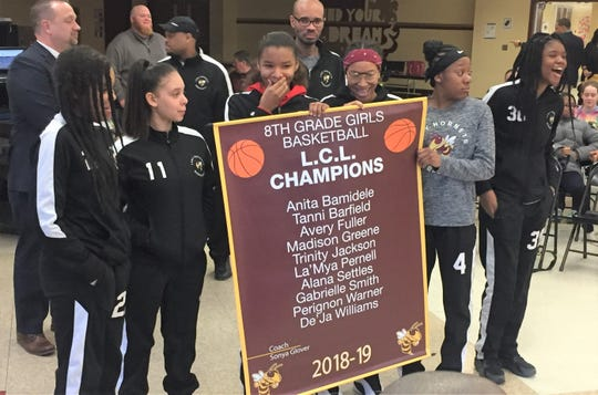 Licking Heights Schools honored its L.C.L. Champion eighth-grade girls basketball team on March 12.