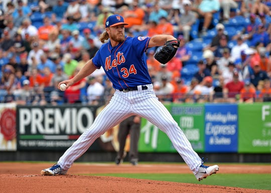 Mar 13, 2019; Port St. Lucie, FL, USA; New York Mets starting pitcher Noah Syndergaard (34) throws against the Houston Astros during a spring training game at First Data Field.