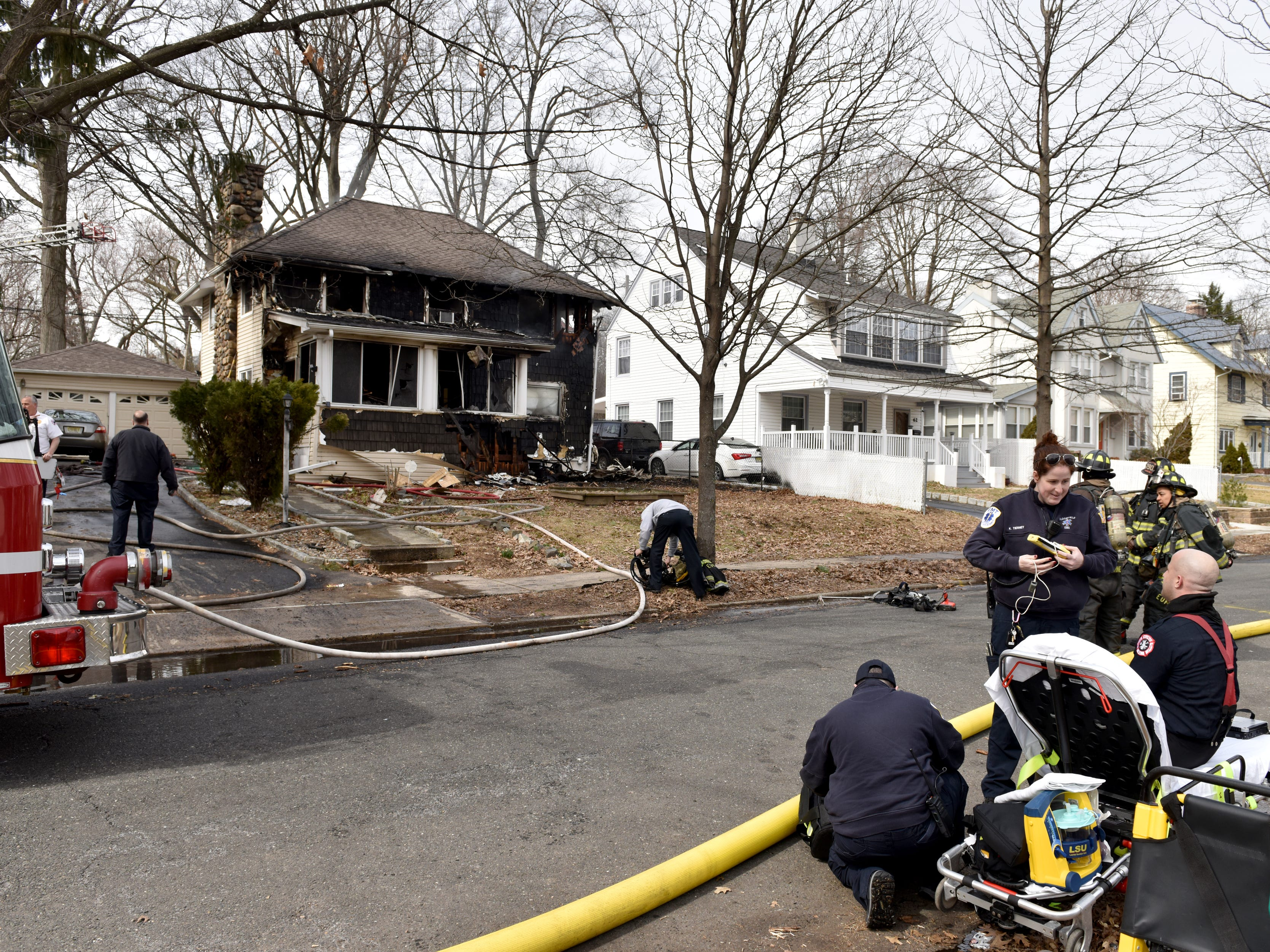 Bloomfield firefighter with assistance with mutual aid companies battle a fire on Willard Ave in Bloomfield on Wednesday March 13, 2019.