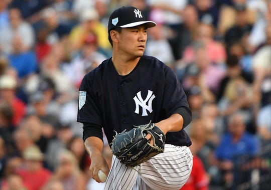 Masahiro Tanaka #19 of the New York Yankees pitches in the first inning during the spring training game against the Philadelphia Phillies at Steinbrenner Field on March 13, 2019 in Tampa, Florida.
