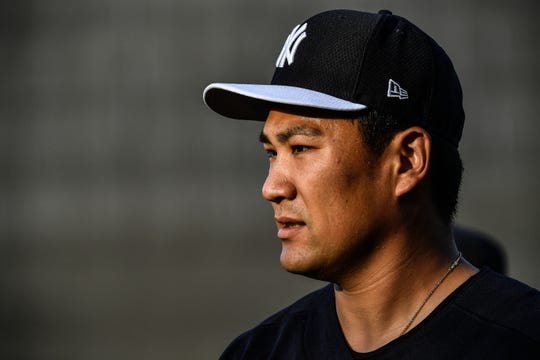 Masahiro Tanaka #19 of the New York Yankees warms up before the spring training game against the Philadelphia Phillies at Steinbrenner Field on March 13, 2019 in Tampa, Florida.