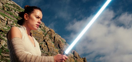 """This image released by Lucasfilm shows Daisy Ridley as Rey in """"Star Wars: The Last Jedi."""""""