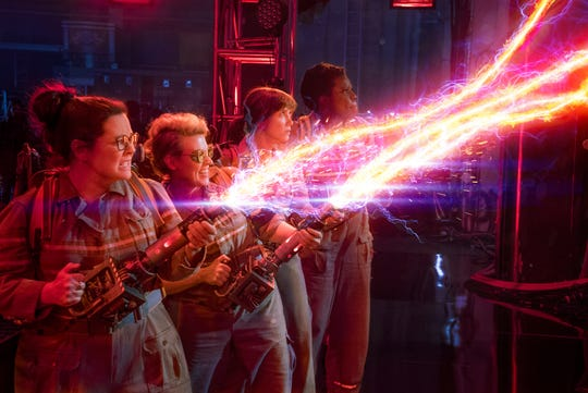 """In this image released by Sony Pictures, from left, Melissa McCarthy, Kate McKinnon, Kristen Wiig and Leslie Jones appear in a scene from, """"Ghostbusters."""""""