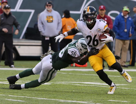 East Rutherford, New Jersey  --  November 9, 2014: Pittsburgh Steelers New York Jets' Demario Davis tackles Pittsburgh Steelers running back Le'Veon Bell in the second half.