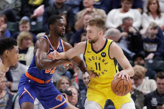 Indiana Pacers' Domantas Sabonis (11) is defended by New York Knicks' Noah Vonleh (32) during the first half of an NBA basketball game Tuesday, March 12, 2019, in Indianapolis. (AP Photo/Darron Cummings)