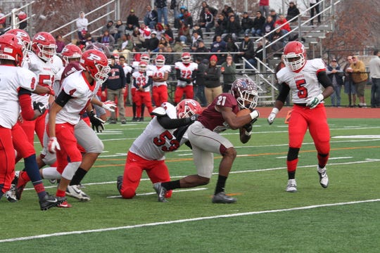 Clifton High School quarterback Saadig Pitts during the annual Thanksgiving day Game versus Passaic High School Indians, Nov. 26, 2015.