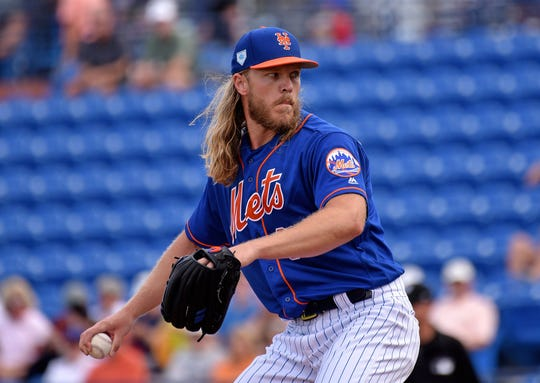 Mar 8, 2019; Port St. Lucie, FL, USA; New York Mets starting pitcher Noah Syndergaard (34) delivers a pitch against the Miami Marlins during a spring training game at First Data Field.
