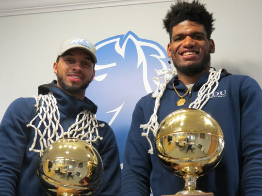 Seniors Darnell Edge (left) and Mike Holloway Jr. are all smiles after Fairleigh Dickinson won the Northeast Conference men's basketball title and a bid to the NCAA Tournament.