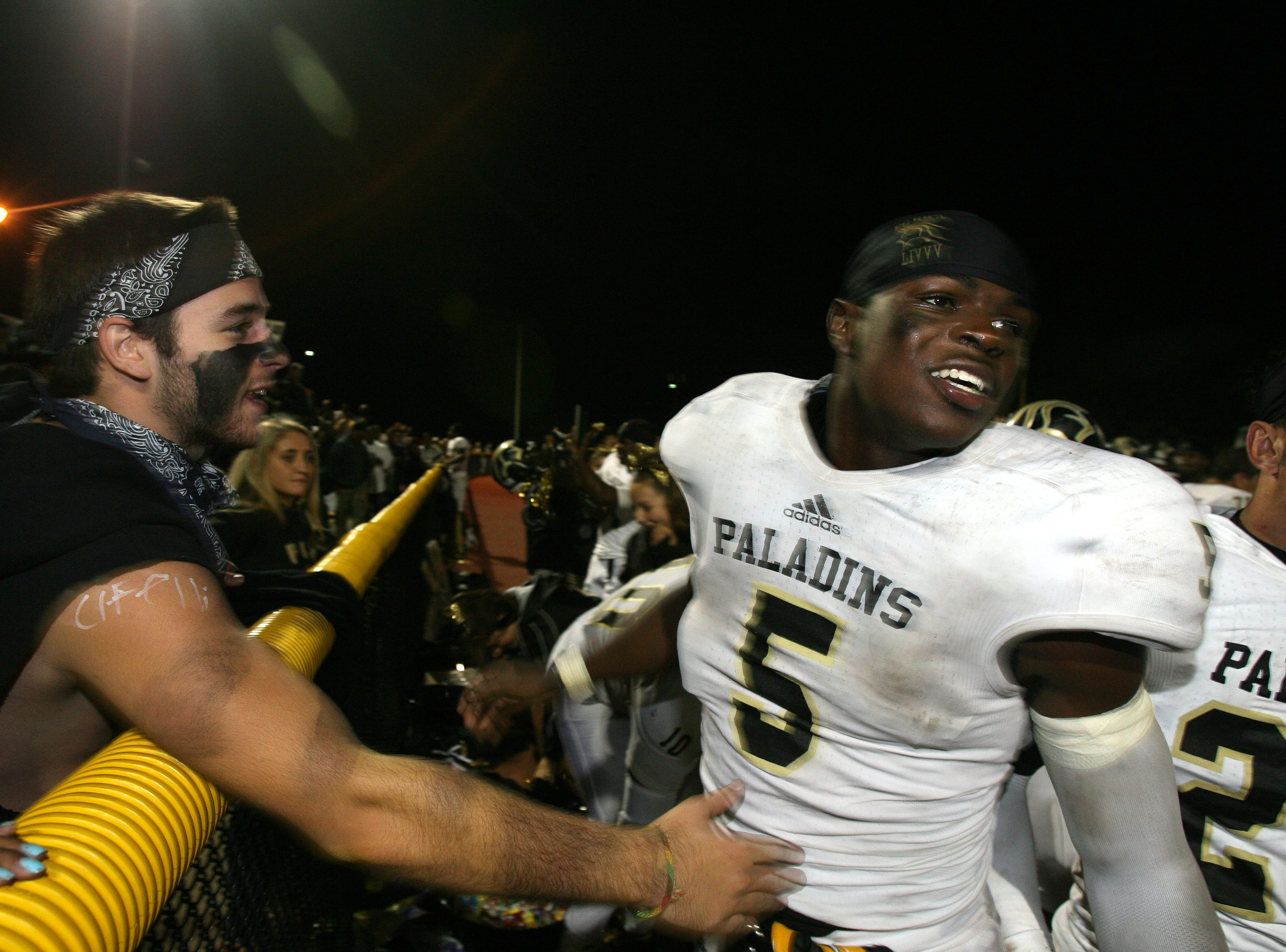 Paramus Catholic's Jabrill Peppers, right,  celebrates  with fans after a 42-10 win over Ridgewood .
