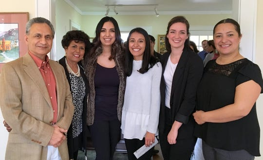 From left, Drs. Rama and Ammu Devasthali gather with Play Sharity board members Crisel Repogle, Kalyn Blazak, Chelsea Newman and Ariana Saludares at the Community Foundation of Southern New Mexico grant award reception.