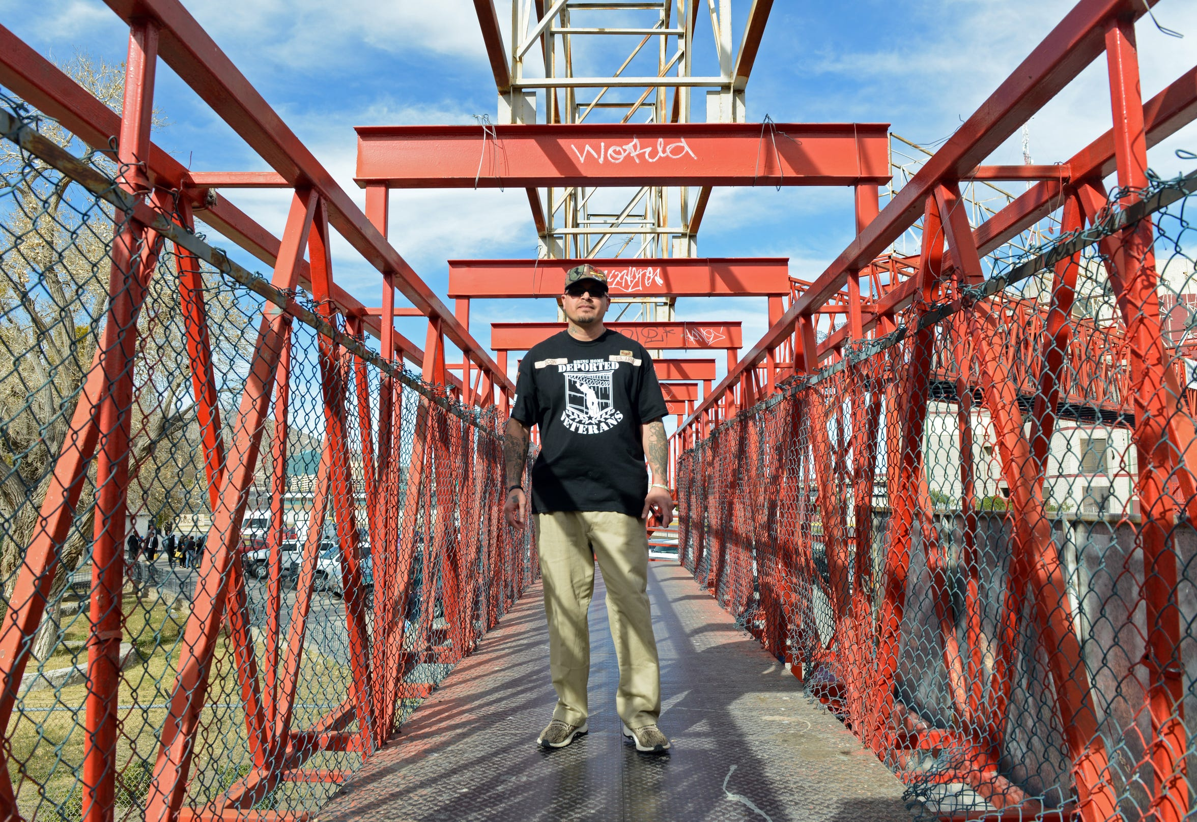 Ivan Ocon stands on a passenger bridge in Juárez, where he has lived since he was deported in 2016.