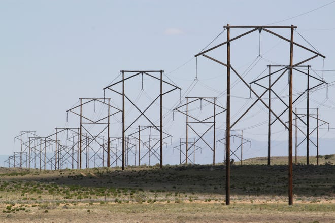 This May 20, 2012 photo shows one of the major transmission lines that runs to the west of Albuquerque, N.M. New Mexico lawmakers are considering legislation during the 2019 session that sets aggressive new quotas for renewable energy production.