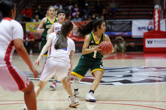 "Mayfield's Alyssa ""Pee-Wee"" Alvarez looks to pass the ball the left side against West Mesa during Tuesday's 5A state quarterfinals game at Dreamstyle Arena in Albuquerque."